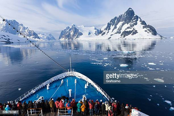 Antarctica tourists on ship driving through Lemaire Channel
