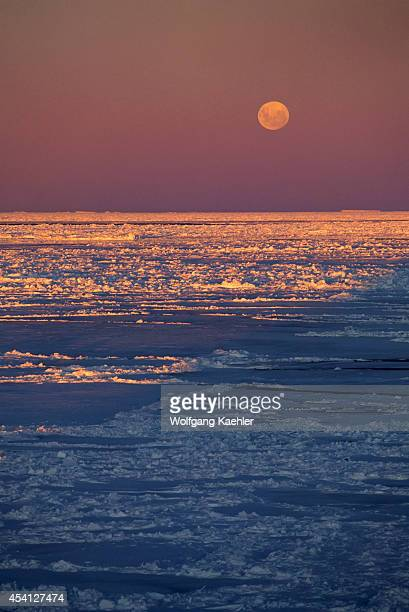 Antarctica Weddell Sea Pack Ice In Midnight Sunshine With Full Moon