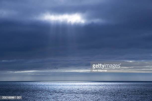 antarctica, weddell sea, sun shining through clouds over sea - weddell sea stock photos and pictures
