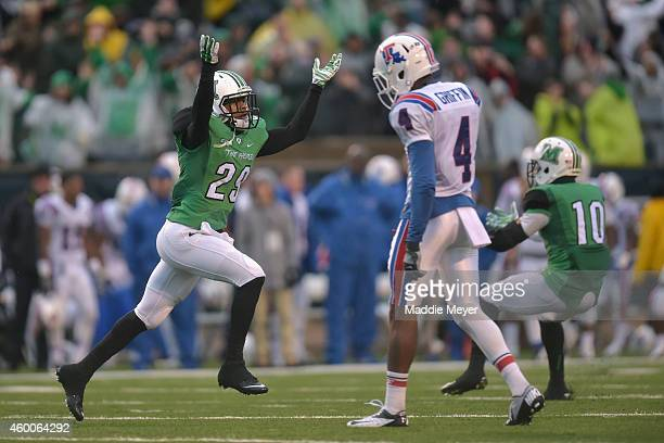 Antavis Rowe of the Marshall Thundering Herd celebrates his teams win over the Louisiana Tech Bulldogs at Joan C Edwards Stadium following the...