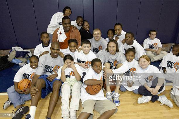 Antawn Jamison Dirk Nowitzki and Steve Nash of the Dallas Mavericks pose with children during the seventh annual Dallas Mavericks Turkey Dunk...
