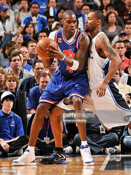Antawn Jamison of the Cleveland Cavaliers posts up against Rashard Lewis of the Orlando Magic during the game on February 21 2010 at Amway Arena in...