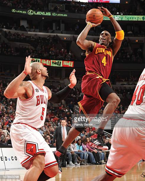 Antawn Jamison of the Cleveland Cavaliers shoots against Carlos Boozer of the Chicago Bulls during the game on January 1 2011 at the United Center in...