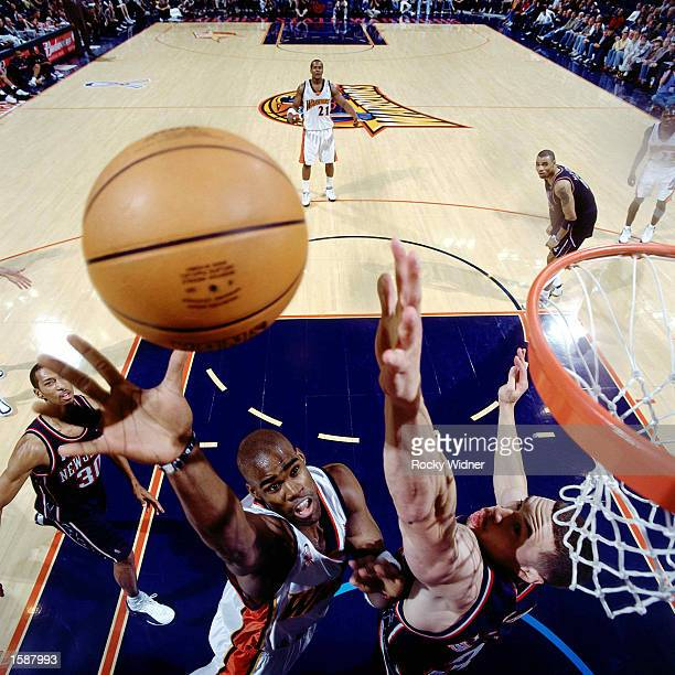 Antawn Jamison of the Golden State Warriors goes up for tip in against the New Jersey Nets on November 25 2001 at The Arena in Oakland California...