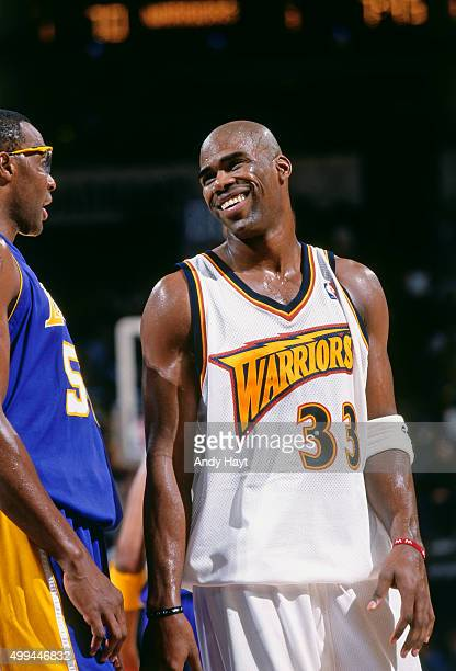 Antawn Jamison of the Golden State Warriors smiles against the Los Angeles Lakers on December 6 2000 at the Arena in Oakland in Oakland California...