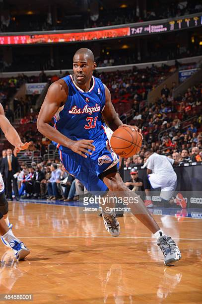 Antawn Jamison of the Los Angeles Clippers drives against the Philadelphia 76ers at the Wells Fargo Center on December 9 2013 in Philadelphia...