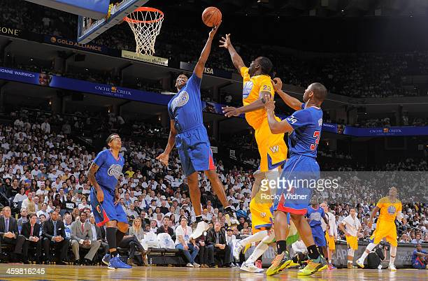 Antawn Jamison of the Los Angeles Clippers rebounds against Draymond Green of the Golden State Warriors on December 25 2013 at Oracle Arena in...