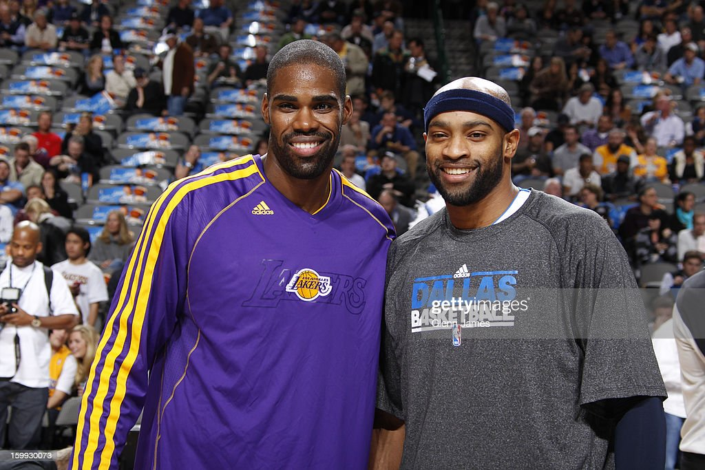 Antawn Jamison #4 of the Los Angeles Lakers and Vince Carter #25 of the Dallas Mavericks pose for a picture before the game on November 24, 2012 at the American Airlines Center in Dallas, Texas.