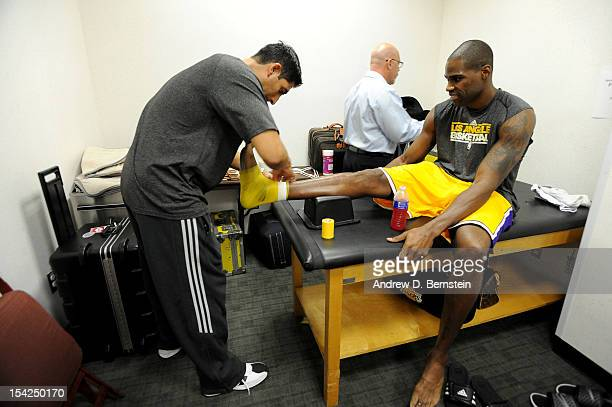 Antawn Jamison of the Los Angeles Lakers gets his foot tapedup prior to a preseason game against the Utah Jazz at the Honda Center on October 16 2012...