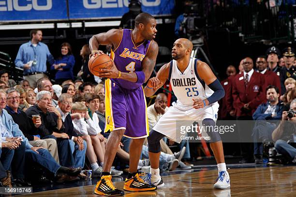 Antawn Jamison of the Los Angeles Lakers is defended by Vince Carter of the Dallas Mavericks on November 24 2012 at the American Airlines Center in...