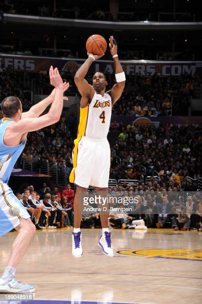Antawn Jamison of the Los Angeles Lakers shoots against Kosta Koufos of the Denver Nuggets at Staples Center on January 6 2013 in Los Angeles...