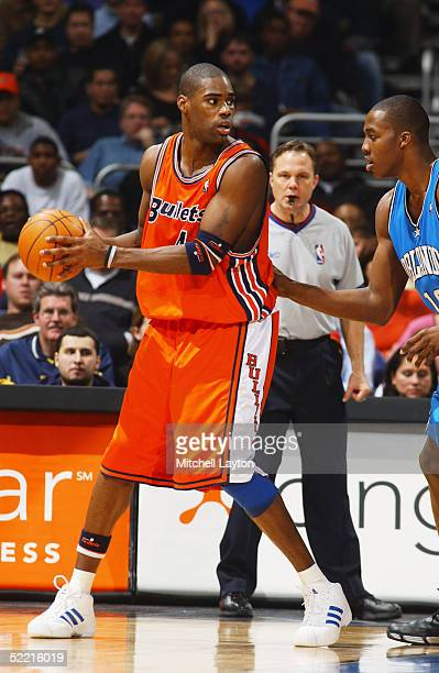 Antawn Jamison of the Washington Wizards looks to pass during the game with the Orlando Magic January 29 2005 at the MCI Center in Washington DC The...