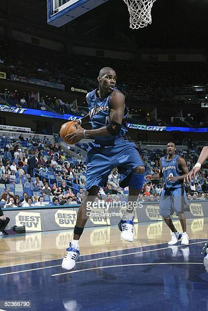 Antawn Jamison of the Washington Wizards rebounds the ball against the New Orleans Hornets during the game at New Orleans Arena on February 14 2005...