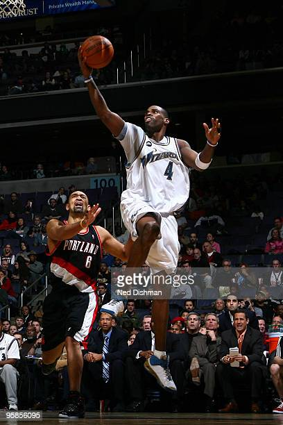 Antawn Jamison of the Washington Wizards shoots against Juwan Howard of the Portland Trail Blazers at the Verizon Center on January 18 2010 in...