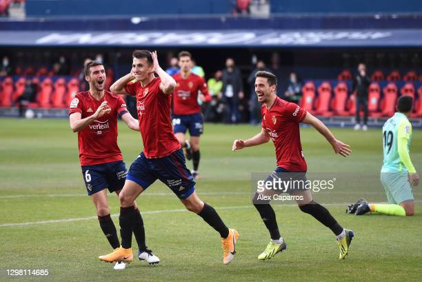Ante Budimir of CA Osasuna celebrates after scoring their sides first goal with team mate Oier during the La Liga Santander match between C.A....