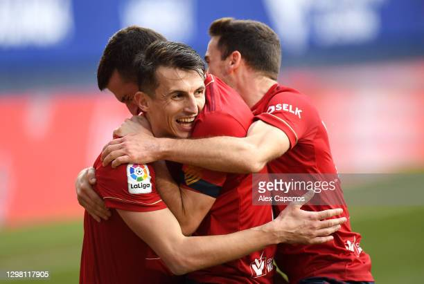 Ante Budimir of CA Osasuna celebrates after scoring their sides first goal with team mates Oier and Kike Barja during the La Liga Santander match...