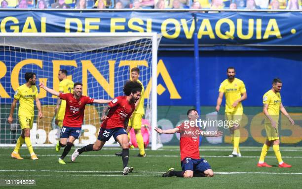 Ante Budimir of CA Osasuna celebrates with Aridane Hernandez after scoring their side's second goal during the La Liga Santander match between...