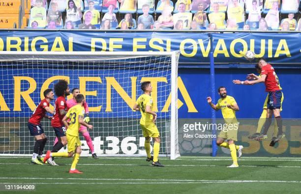 Ante Budimir of CA Osasuna scores their side's second goal past Sergio Asenjo of Villarreal CF during the La Liga Santander match between Villarreal...