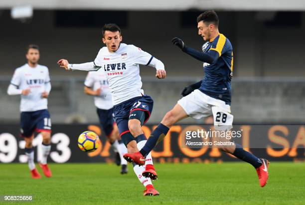 Ante Budimir of FC Crotone competes for the ball whit Alex Ferrari of Hellas Verona during the serie A match between Hellas Verona FC and FC Crotone...