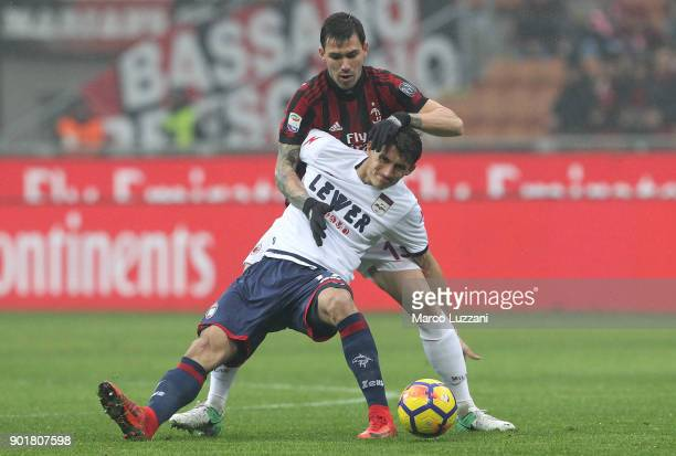 Ante Budimir of FC Crotone competes for the ball with Alessio Romagnoli of AC Milan during the serie A match between AC Milan and FC Crotone at...