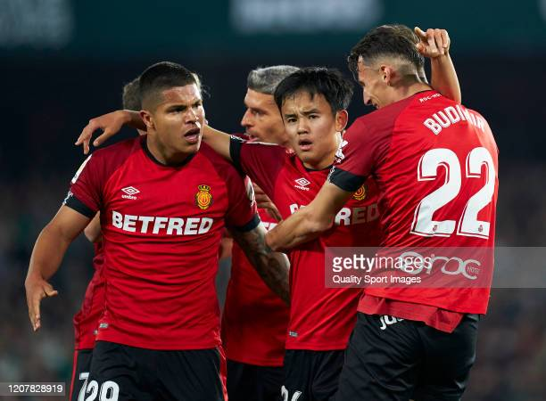 Ante Budimir of RCD Mallorca celebrates after scoring his team's second goal with his teammates Takefusa Kubo and Juan Camilo Hernandez during the...