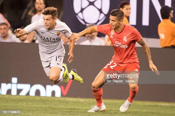 Ante Coric of AS Roma challenged by Javi Sánchez of Real Madrid in action during the Real Madrid vs AS Roma International Champions Cup match at...
