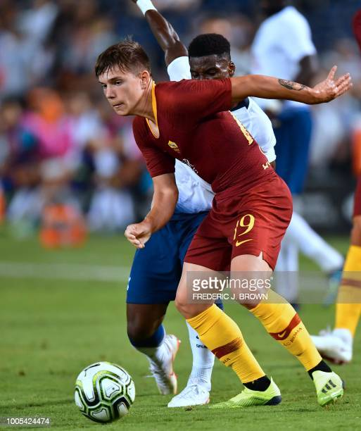 Ante Coric of AS Roma vies for the ball with Serge Aurier of Tottenham Hotspur during their International Champions Cup match in San Diego California...