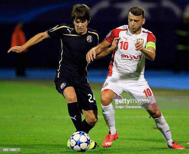 ZAGREB CROATIA AUGUST 25 Ante Coric of Dinamo Zagreb in action against Bledi Shkembi of KF Skenderbeu during the UEFA Champions League Qualifying...