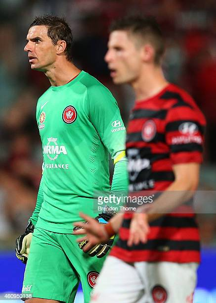 Ante Covic and Shannon Cole of the Wanderers react towards a group of RBB fans following the round 14 ALeague match between the Western Sydney...