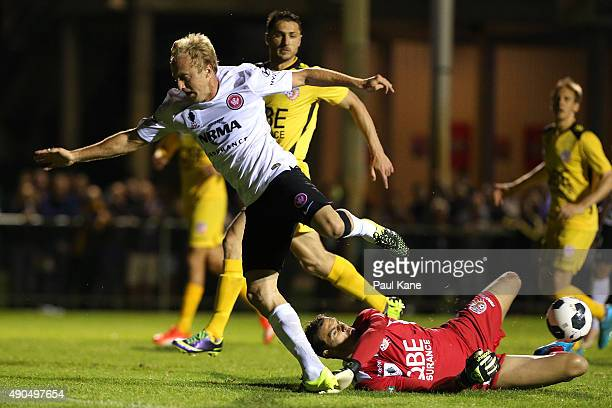 Ante Covic of the Glory saves a shot on goal by Mitch Nichols of the Wanderers during the FFA Cup Quarter Final match between the Perth Glory and...
