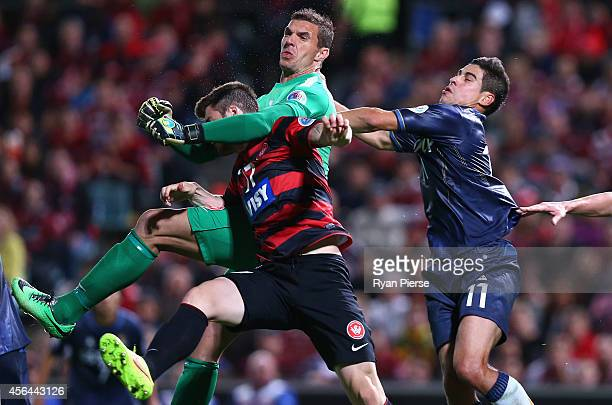 Ante Covic of the Wanderers collides with team mate Brendan Hamill of the Wanderers during the Asian Champions League semi final leg 2 match between...