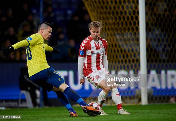 Ante Erceg of Brondby IF and Patrick Kristensen of AaB Aalborg compete for the ball during the Danish Superliga match between Brondby IF and AaB...