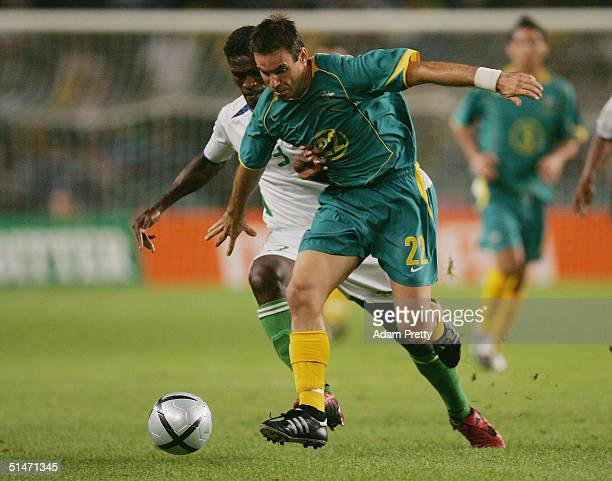 Ante Milicic of Australia in action during the Oceania Nations Cup and the Confederations Cup last qualifying match between Australian Socceros and...