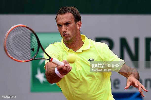 Ante Pavic of Croatia returns a shot during his men's singles match against Gilles Simon of France on day two of the French Open at Roland Garros on...