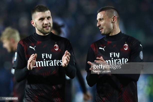 Ante Rebic and Rade Krunic of AC Milan celebrate a victory at the end of the Serie A match between Brescia Calcio and AC Milan at Stadio Mario...