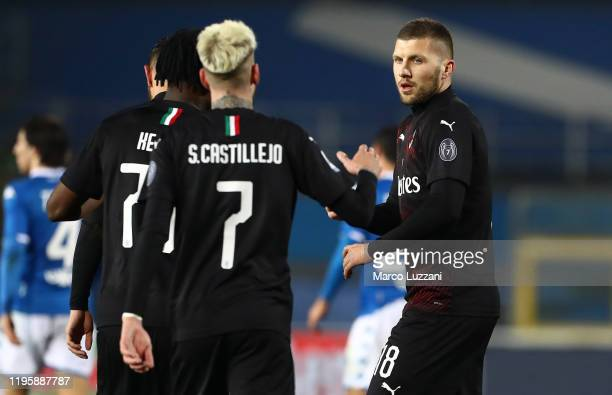Ante Rebic of AC Milan ccelebrates with Samuel Castillejo after scoring the opening goal during the Serie A match between Brescia Calcio and AC Milan...