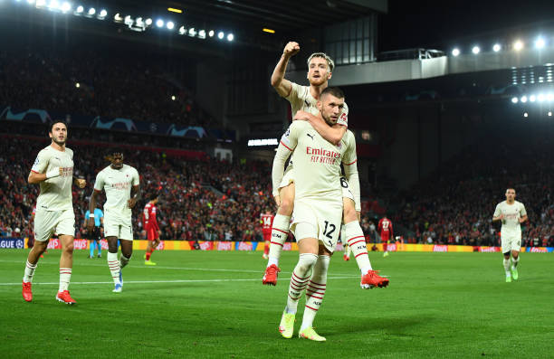 Ante Rebic of AC Milan celebrates after scoring his team's first goal with teammate Alexis Saelemaekers during the UEFA Champions League group B...
