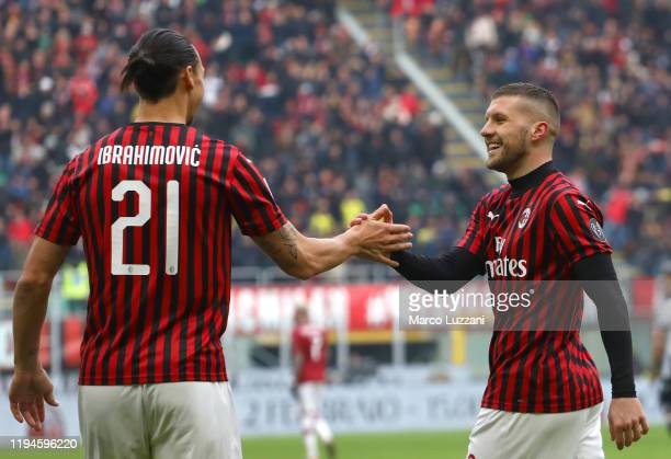 Ante Rebic of AC Milan celebrates his goal with his team-mate Zlatan Ibrahimovic during the Serie A match between AC Milan and Udinese Calcio at...