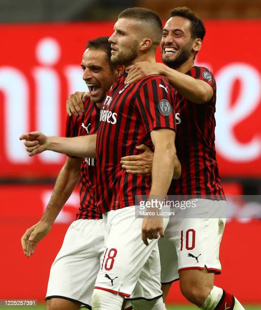 Ante Rebic of AC Milan celebrates his goal with his team-mates Hakan Calhanoglu and Giacomo Bonaventura during the Serie A match between AC Milan and...