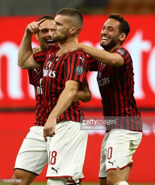 Ante Rebic of AC Milan celebrates his goal with his team-mates Hakan Calhanoglu and Giacomo Bonaventura during the Serie A match between AC Milan and...