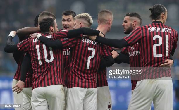 Ante Rebic of AC Milan celebrates with his teammates after scoring the opening goal during the Serie A match between FC Internazionale and AC Milan...