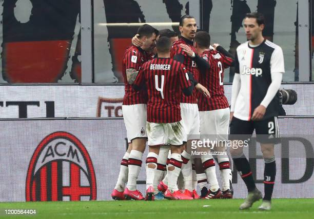 Ante Rebic of AC Milan celebrates with his teammates after scoring the opening goal during the Coppa Italia Semi Final match between AC Milan and...