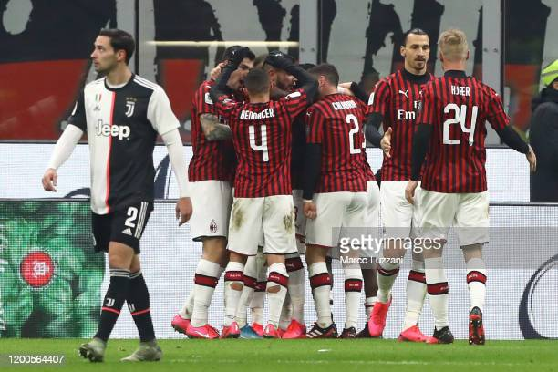 Ante Rebic of AC Milan celebrates with his team-mates after scoring the opening goal during the Coppa Italia Semi Final match between AC Milan and...