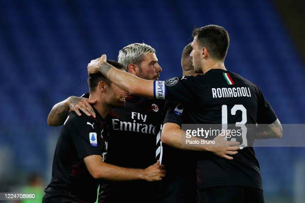 Ante Rebic of AC Milan celebrates with his teammates after scoring the team's third goal during the Serie A match between SS Lazio and AC Milan at...