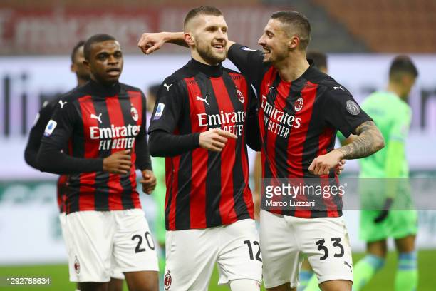 Ante Rebic of AC Milan celebrates with team mates Rade Krunic and Pierre Kalulu after scoring their sides first goal during the Serie A match between...