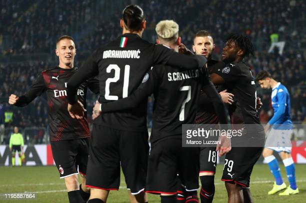 Ante Rebic of AC Milan celebrates with teammates after scoring the opening goal during the Serie A match between Brescia Calcio and AC Milan at...