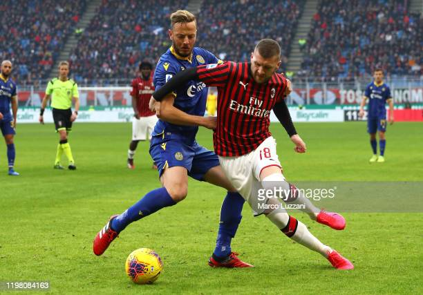 Ante Rebic of AC Milan competes for the ball with Amir Rrahmani of Hellas Verona during the Serie A match between AC Milan and Hellas Verona at...