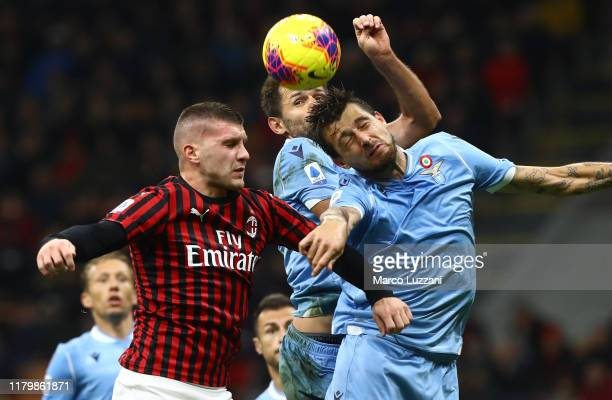 Ante Rebic of AC Milan competes for the ball with Francesco Acerbi of SS Lazio during the Serie A match between AC Milan and SS Lazio at Stadio...