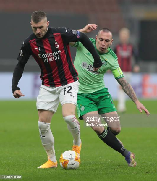 Ante Rebic of AC Milan is challenged by Scott Brown of Celtic FC during the UEFA Europa League Group H stage match between AC Milan and Celtic at San...