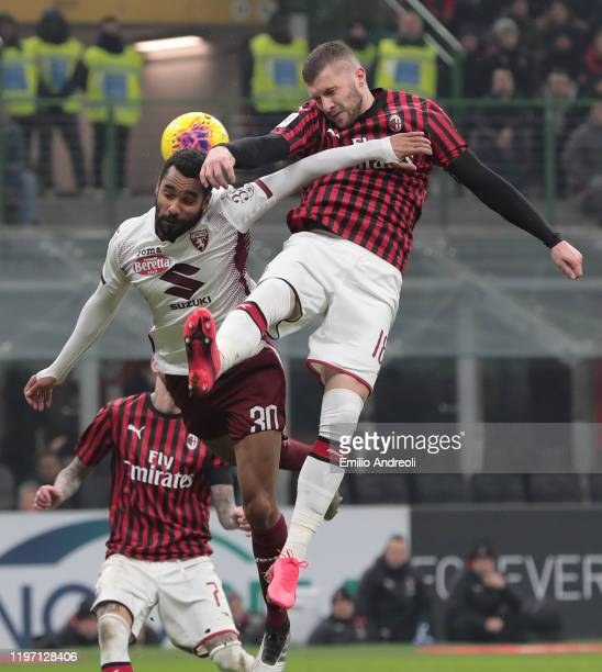 Ante Rebic of AC Milan jumps for the ball against Koffi Djidji of Torino FC during the Coppa Italia Quarter Final match between AC Milan and Torino...
